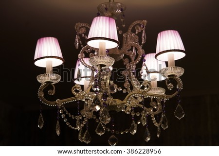 Crystal chandelier with purple shades and crystal pendants