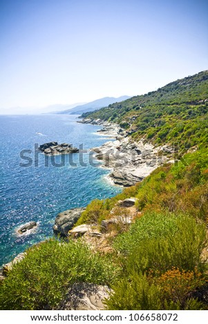Crystal clean sea along beuty green coastline in amazing island Corsica - stock photo