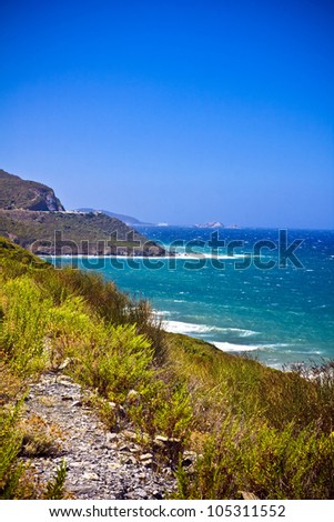 Crystal clean sea along white sand beach in amazing island Corsica - stock photo