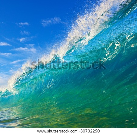 Crystal Clear Aqua Blue Wave Breaks in Ocean - stock photo