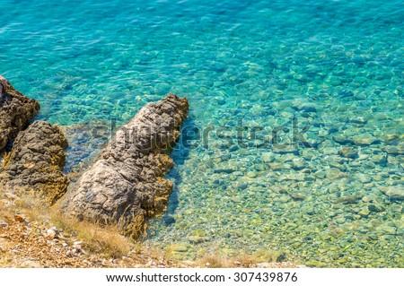 Crystal clear blue Adriatic sea rocky beach on island Krk, Croatia - stock photo