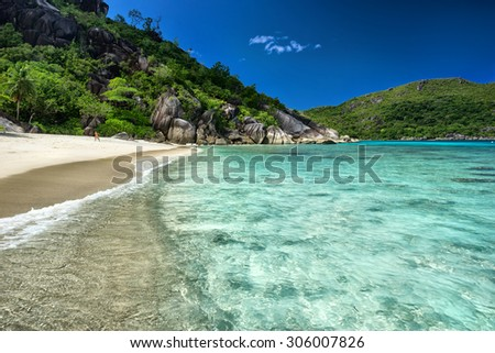 Crystal clear blue water of tropical island / outdoors photography of picturesque Seychelle islands - stock photo