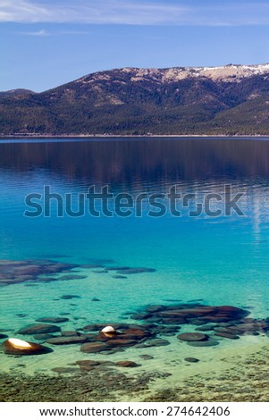 Crystal clear blue waters of Lake Tahoe in California - stock photo