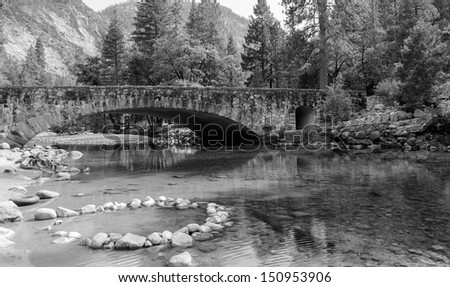 Crystal clear spring and a beautiful stone bridge in Yosemite Valley.