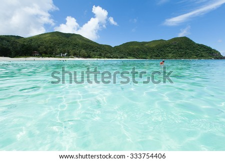 Crystal clear tropical water and white sand beach, Tokashiki Island of the Kerama Islands National Park, Okinawa, Japan - stock photo