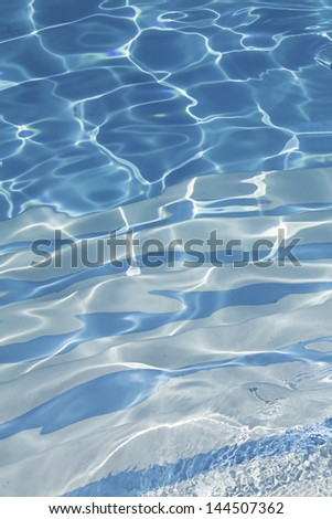 Crystal clear water and bright sports complex pool, vacation - stock photo