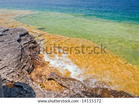 Crystal clear water washing rocky (dolomite) coastline