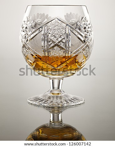 crystal cup goblet with engravings filled with alcohol