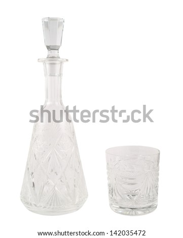 Crystal decanter vessel with a plug stopper inside and glass tumbler isolated over white background - stock photo
