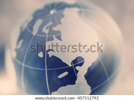 Crystal glass model of globe. Close up, no models. Concept for international affairs, global business. Focus on Northern America continent - stock photo