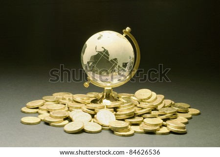 Crystal Globe and Coins on Seamless Background - stock photo