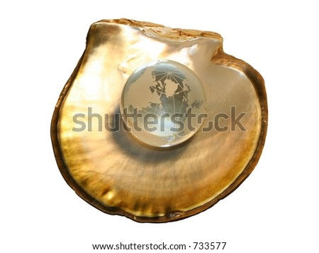 Crystal globe on oyster shell, golden version-concept Shallow depth of field on globe