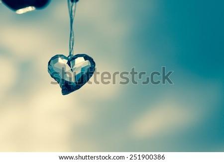 Crystal heart over blue sky - stock photo