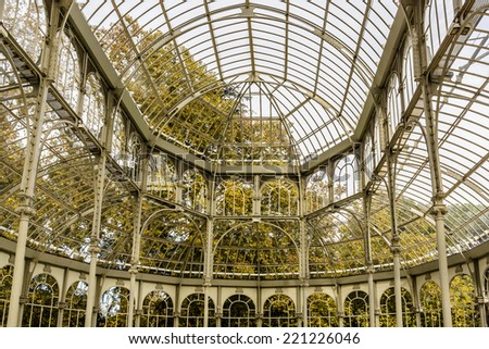 Crystal Palace (Palacio de cristal) in the Retiro Park in Madrid. Spain. It was built in 1887 to exhibit flora and fauna from the Philippines. The architect was Ricardo Velazquez Bosco. Interior. - stock photo