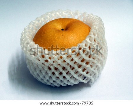 Crystal pear in protective wrapper - stock photo