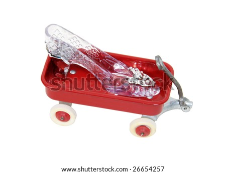 Crystal Slipper representing fashion and cinderella-like fantasies on a little red wagon-Path orig size - stock photo