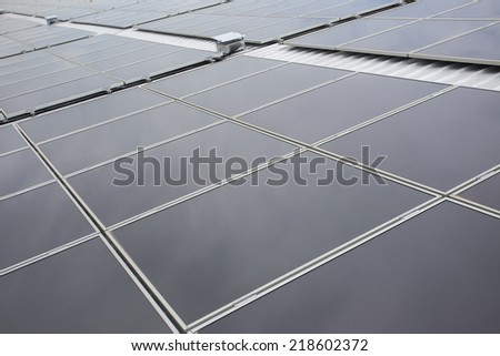 Crystalline Silicon Photovoltaics on roof - stock photo