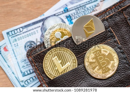 crytocurrency bitcoin , litecoin, ripple and ethereum on wallet pocket
