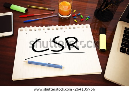 CSR - Corporate Social Responsibility - handwritten text in a notebook on a desk - 3d render illustration. - stock photo