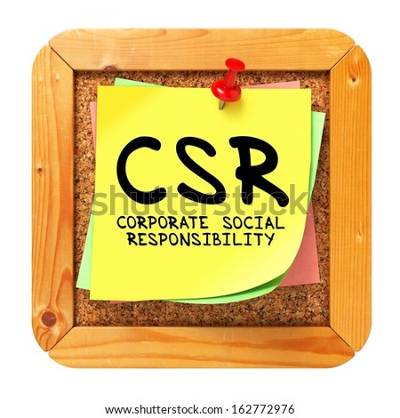 CSR - Corporate Social Responsibility - Written on Yellow Sticker on Cork Bulletin or Message Board. - stock photo