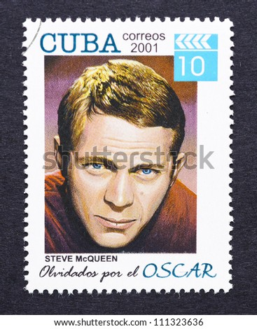 CUBA - CIRCA 2001: a postage stamp printed in Cuba showing an image of Steve McQueen, circa 2001. - stock photo