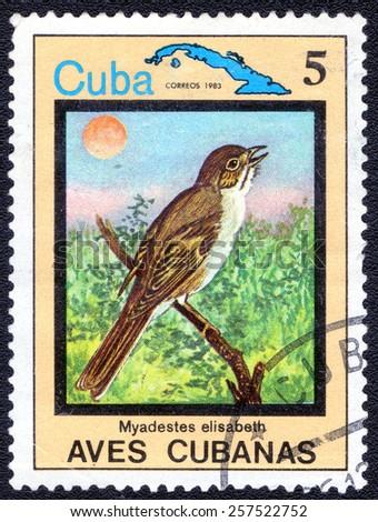 """CUBA - CIRCA 1983:A postage stamp shows Myadestes elisabeth, from series """"Cuban Birds"""", circa 1983 - stock photo"""