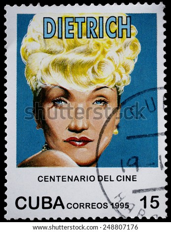 "CUBA - CIRCA 1995: A stamp printed in Cuba from the ""Centenary of Motion Pictures. Designs showing film stars"" issue shows Marlene Dietrich, circa 1995. - stock photo"