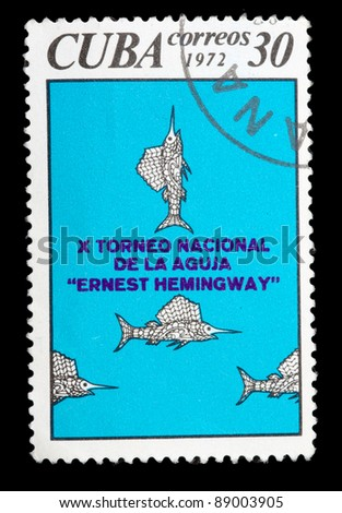 CUBA - CIRCA 1972: A stamp printed in Cuba is devoted to the national tournament on catching a fish-sword in memory of Ernest Hemengway, circa 1972. - stock photo