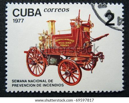 CUBA - CIRCA 1977: A stamp printed in Cuba show the ancient car, circa 1977 - stock photo