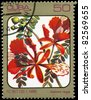 "CUBA - CIRCA 1984: A Stamp printed in CUBA shows image of a Delonix regia, from the series ""Caribbean Flowers"", circa 1984 - stock photo"