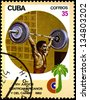 "CUBA - CIRCA 1982: A stamp printed in CUBA shows Weightlifting, with inscription and name of series ""XIV Central American and Caribbean Games, Havana"", circa 1982 - stock photo"