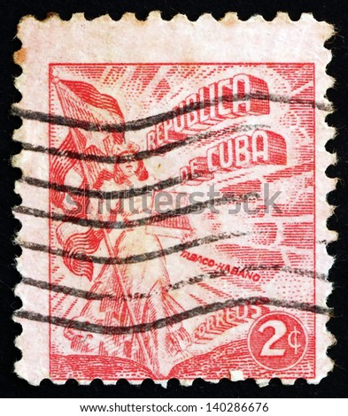 CUBA - CIRCA 1948: a stamp printed in the Cuba shows Liberty Carrying Flag and Cigars, Cuba'??s Tobacco Industry, circa 1948 - stock photo