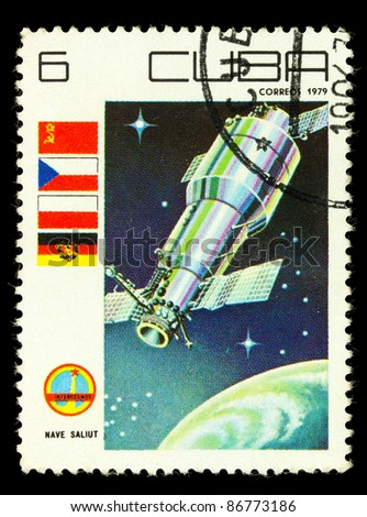 CUBA - CIRCA 1979: A vintage postal stamp printed in Cuba, depicting a space satellite named Nave Saliut in orbit circa 1979 - stock photo