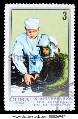 CUBA - CIRCA 1971: An airmail stamp printed in Cuba shows training of a spaceman, series, circa 1971. - stock photo
