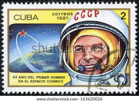 CUBA - CIRCA 1981: cancelled stamp printed in CUBA, shows first russian, soviet astronaut Yury Gagarin, space-vehicle shuttle orbit, circa 1981. 20 anniversary of 1st space flight. - stock photo