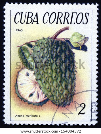 CUBA - CIRCA 1965: post stamp printed in Cuba shows image of custard apples (anona muricata, soursop, pawpaw) from tropical fruit series, Scott catalog 1018 A312 2c green yellow brown, circa 1965 - stock photo