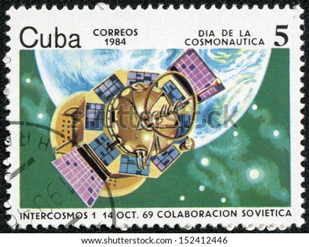 CUBA CIRCA 1984: stamp printed by CUBA, shows Cosmonautics Day - Intercosmos January 14 October 69 Soviet cooperation, CIRCA 1984