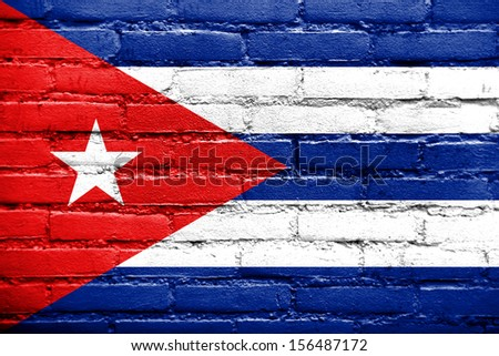 Cuba Flag painted on old brick wall - stock photo
