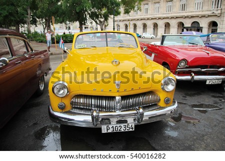 Cuba, Havana - August 14, 2016: front view of an amazing vintage american classic car, waiting for tourists to take a ride on the streets of Old Havana.