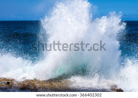 Cuba. Island. Ocean. Sea. Waves breaking on the shore. White spray soar high. Storm. Freedom. Blue water. Nature - stock photo