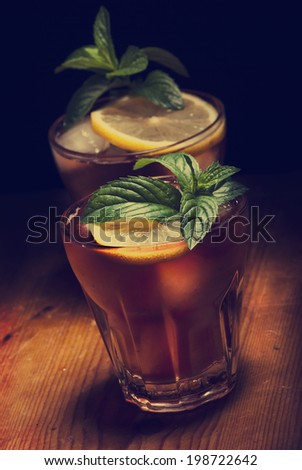 Cuba Libre cocktail on rustic wooden background - stock photo