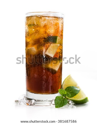 Cuba Libre Longdrink with brown rum and lime (isolated on white background) - stock photo