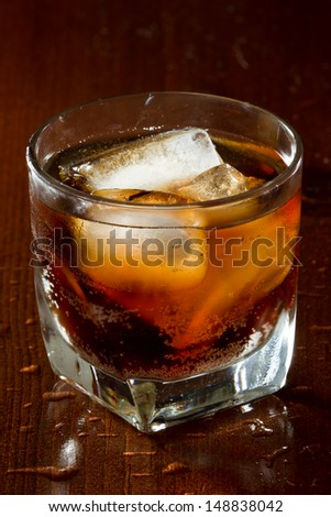 cuba libre, rum and cola cocktail served in a short glass - stock photo