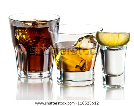Cuba libre, whiskey on the rocks and tequila shot - stock photo