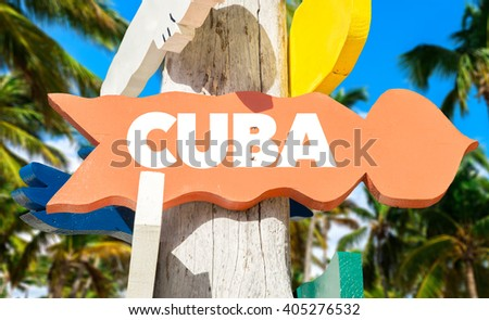 Cuba signpost with palm trees - stock photo