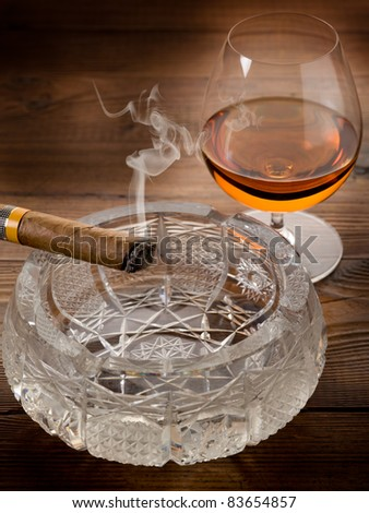 Cuban cigar and liquor drink on wood background - stock photo