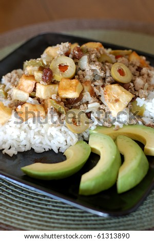 Cuban Picadillo on White Rice with Avocado Slices - stock photo