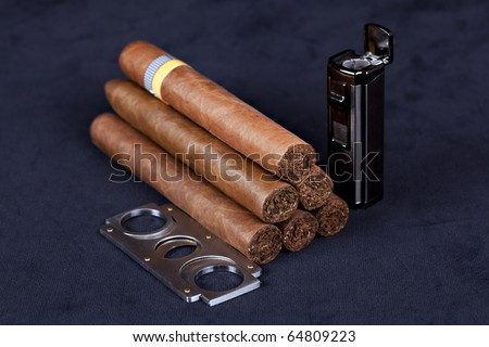 Cuban top cigars with lighter and cutter - stock photo