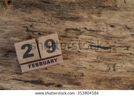 cube calendar for february on wood - stock photo