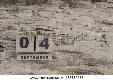 cube calendar for september on wooden background with copy space - stock photo